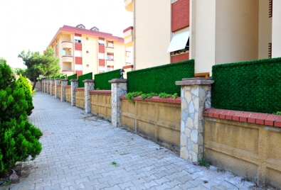 Grass Fence Wall Coating Application